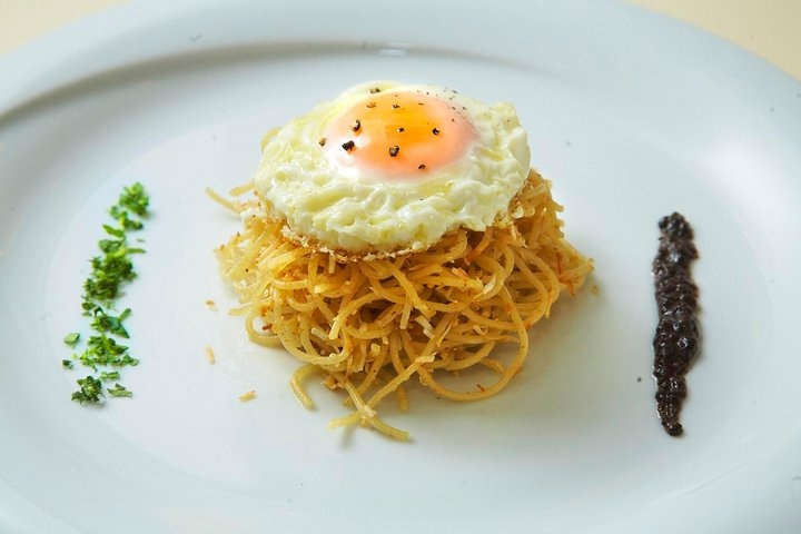 """Tsouchtes""   (traditional pasta) with roasted sour mitzithra cheese, covered with a fried egg  #MANHMANH #Athensrestaurant #greekcuisine"