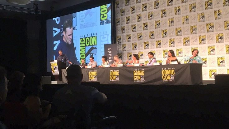 SYFY's The Expanse just landed at San Diego Comic-Con. Executive producers Naren Shankar and Mark Fergus joined cast members Steven Strait, Dominique Tipper, Wes Catham, Shohreh Aghdashloo, Cas Anvar, and Frankie Adams to hit the stage Saturday afternoon and discuss the jaw-dropping moments of last season and what we can expect in Season 3.