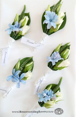 Powder Blue tweedia, spray rose, veronica and lisianthus bud buttonholes, bound in white satin.