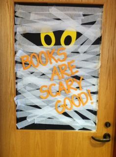 "Mummy wrapped door. Halloween. Display. Library. Decorations. Fall. Autumn. ""Books are scary good!"""