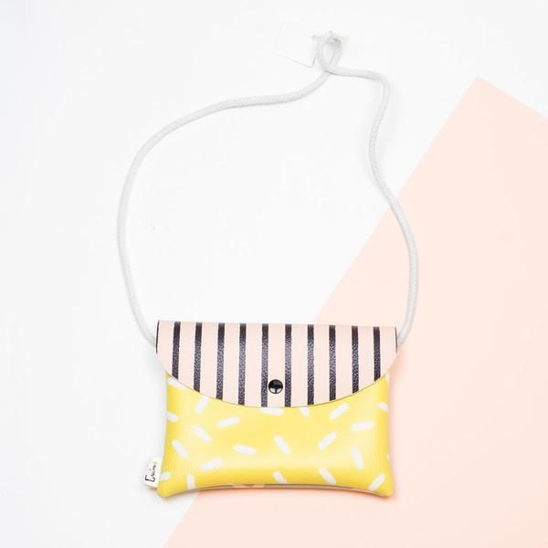 Say bye-bye to big purse black holes and get one of these colourful mini purses; you wont fit that Chihuahua you've carrying around in your old purse but it will be just fine. We promise. - Made of Sundays -