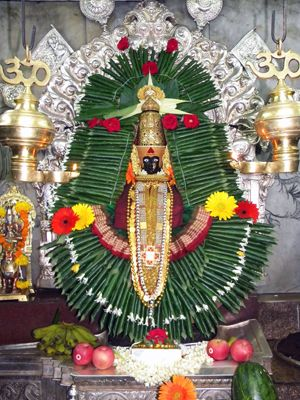 'करवीर क्षेत्र माहात्म्य' तथा 'लक्ष्मी विजय' के अनुसार कौलासुर दैत्य को वर प्राप्त था कि वह स्त्री द्वारा ही मारा जा सकेगा, अतः विष्णु स्वयं महालक्ष्मी रूप में प्रकटे और सिंहारूढ़ होकर करवीर में ही उसको युद्ध में परास्त कर संहार किया। मृत्युपूर्व उसने देवी से वर याचना की कि उस क्षेत्र को उसका नाम मिले। देवी ने वर दे दिया और वहीं स्वयं भी स्थित हो गईं, तब इसे 'करवीर क्षेत्र' कहा जाने लगा, जो कालांतर में 'कोल्हापुर' हो गया।