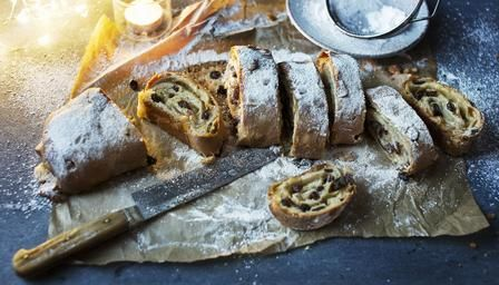 Stollen---A delicious yeasted cake filled with dried fruit and a swirl of marzipan. It takes time to make but is well worth the effort.