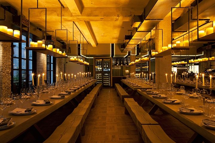 Beast restaurant by designLSM, London – UK Our solution takes influence from medieval banqueting halls and the restaurant features six massive tables, each one a thick slab of oak measuring 6 metres in length. Long benches run the length of each table.
