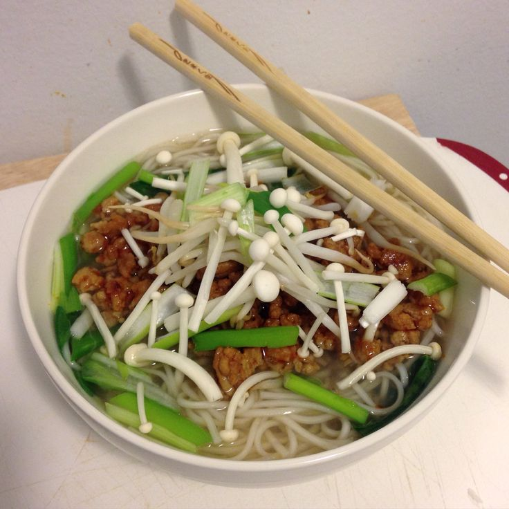 ... topped with enoki mushrooms, tantan pork, green onion and bean spouts