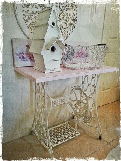 Created by Vintage Lidy.  The Singer table, the shabby birdhouse, wire basket, prints...love it all.  Cute vignette.