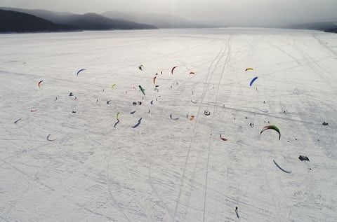 Kite-boarders and kite-skiers compete during the regional championships on the ice-covered Yenisei River.