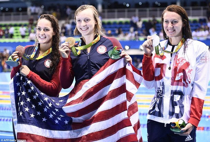 Ledecky (C) posed with silver medallist Britain's Jazz Carlin (R) and bronze…