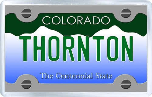 $3.29 - Acrylic Fridge Magnet: United States. License Plate of Thornton Colorado