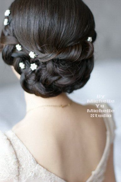 I don't really like this all that much, but I want something simple and elegant like this. This however, looks a little too hairsprayed for my taste.