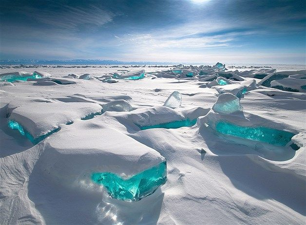 Russia's frozen Lake Baikal is covered in naturally occurring formations called ice hummocks. Created by the area's extreme weather conditions, these picturesque blocks can reach a height of 50 feet.
