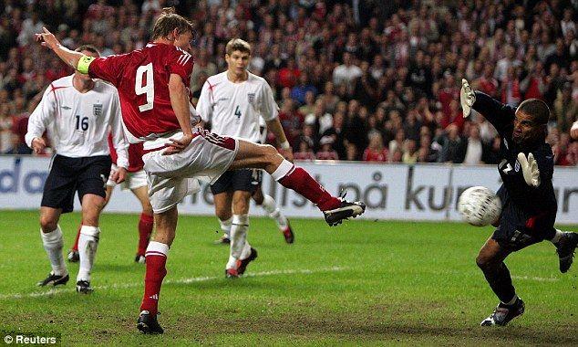 In 2005 Jon Dahl Tomasson scores past David James, as Denmark beat England 4-1