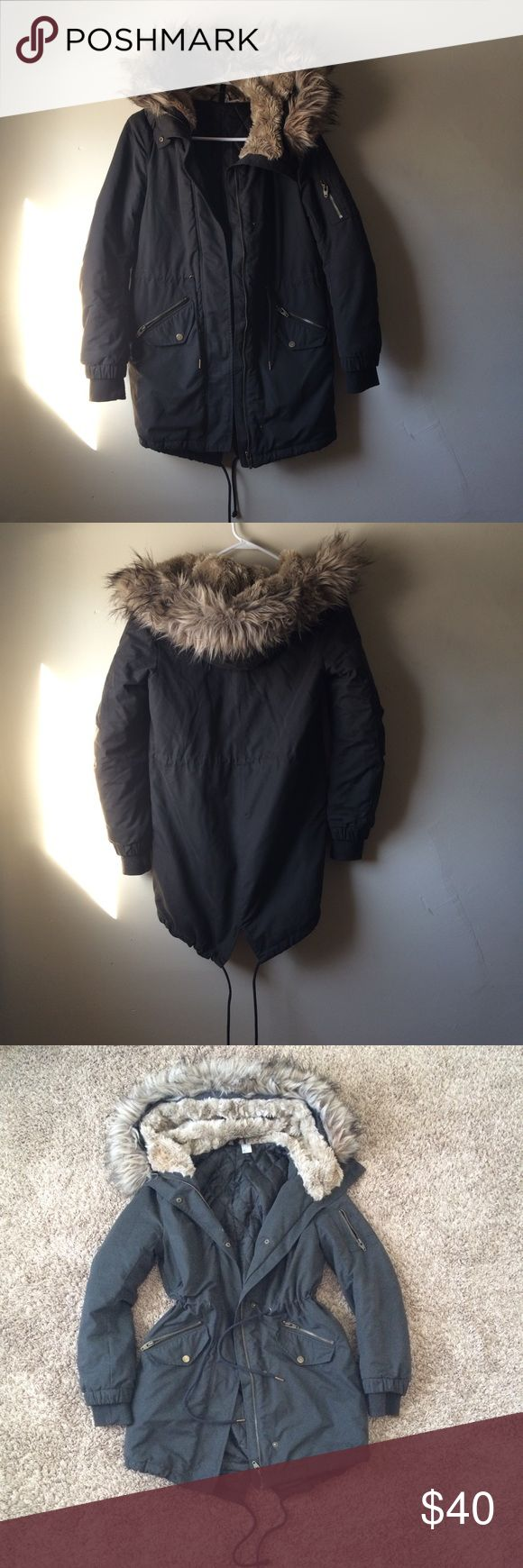H&M Black Parka coat Women's H&M Black Parka fur hooded bomber coat size 2 can fit a S-M  Has removable fur around hood  With faux fur in the inside of hood to keep you extra warm Has strings to pull in waist and bottom of coat Only selling because I want it in army green   In great condition H&M Jackets & Coats Utility Jackets