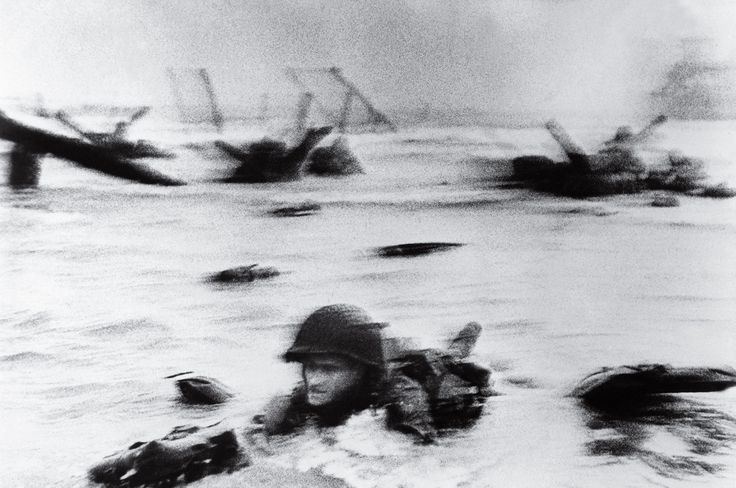 "ROBERT CAPA / D-Day, 1944 / ""It never occurred to me until later that in order to take that picture, Capa had to get ahead of that soldier and turn his back on the action."""