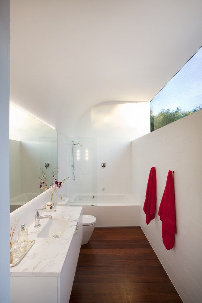 modern white bathroom, marble counter, clerestory window for privacy & light, by David Barr Architect