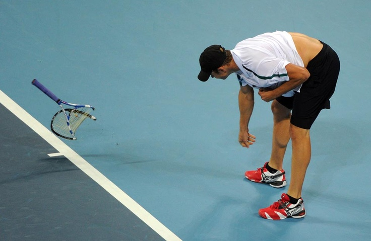 Andy Roddick of the U.S. smashed his tennis racquet onto the court during his match against Kevin Anderson of South Africa in the China Open tennis tournament, at the National Tennis Center in Beijing Oct. 3, 2011. Mark Ralston/AFP/Getty Images