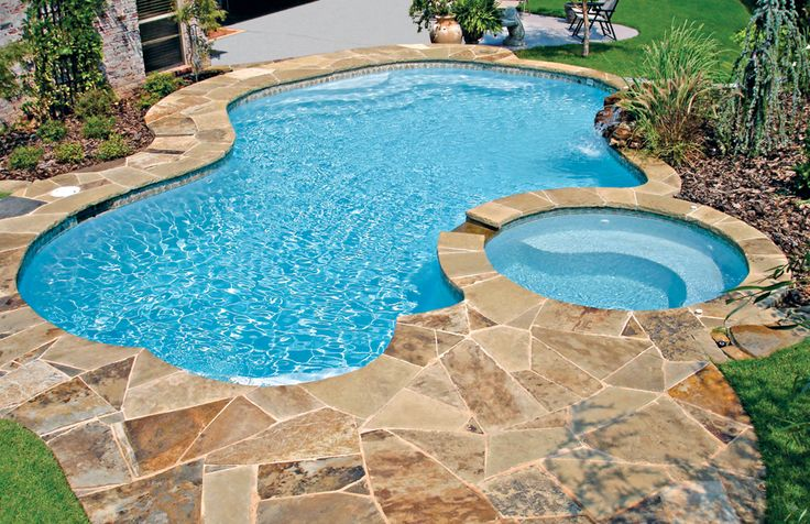 Free-Form Pools | Blue Haven Pools. Nice big spa balances out small pool.