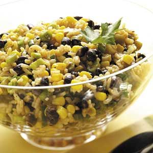 """Fiesta Side Salad Recipe -""""Perfect for a buffet, picnic or potluck, this colorful side can be served at room temperature,"""" says  Michelle Chicoine of Missoula, Montana. """"You'll want to make extra because the flavors only get better the second day!"""" TASTY TIP Toasting whole cumin seeds and then grinding them adds extra flavor to this salad. If you don't have whole cumin seeds, substitute 1/4 teaspoon of ground cumin—don't toast."""