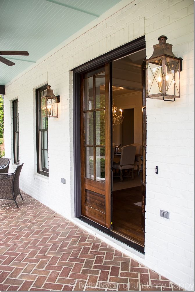 Front porch goals- LOVE the double wooden front doors and the porch light lanterns!