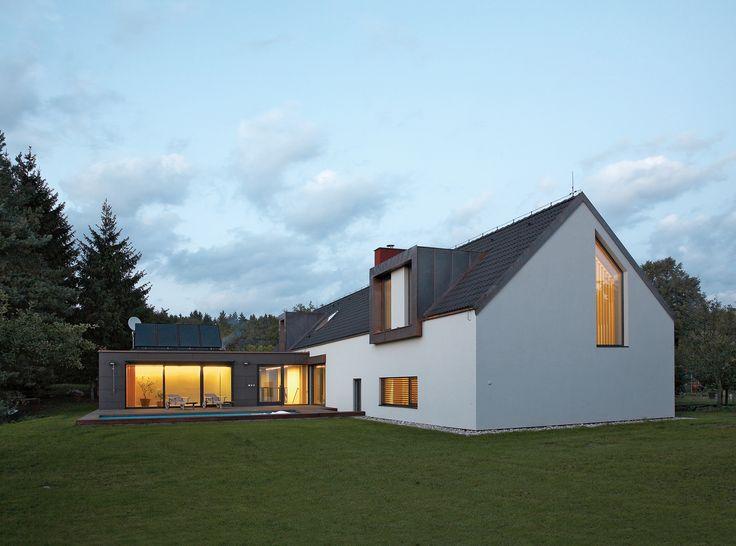 Sustainable modern bohemian home   Geothermal heat pumps & solar panels provide renewable power for 90% of the home's electricity needs in Czech Republic by Martina Buřičová and Štěpán Kubíček.
