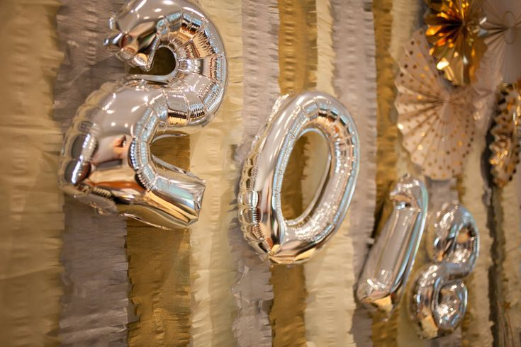 Air-filled metallic silver number balloons- perfect for any celebration!