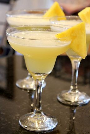 Pineapple Margaritas  1 cup good tequila 1 cup pineapple juice 1/4 cup freshly squeezed lime juice 6 tablespoons triple sec 4 teaspoons granulated white sugar 2 tablespoons Cointreau crushed ice lime slices or pineapple slices for garnish (optional)