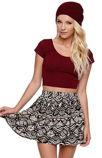 The link goes to the skirt, but I love this outfit. The red crop top with a beanie and short black and white skater skirt