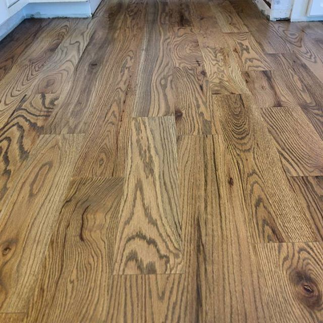Newly installed 5 inch red oak sand on site. Finished with a weathered oak stain…