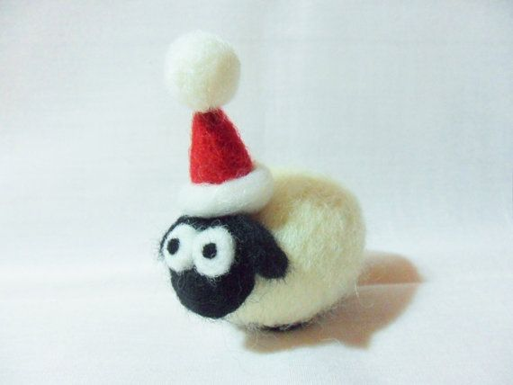 This is a cute, handmade by me, needle felted sheep Christmas decoration. He would look great on a shelf, hanging on your tree, or could even brighten up your desk. He is completely unique and the listing is for the actual one in the photo.    He is made from natural white shetland wool, with a merino wool face and feet and a lovely red hat with a bobble. He doesnt come ready to hang up, but if you would like a loop threading through, please choose the variation with hanging loop and I will…