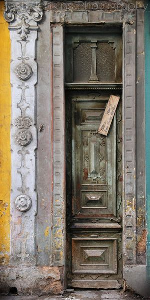 perhaps...one day...legally or not...I shall travel to Cuba, find this door, and with Buena Vista Social Club playing in my ears, I'll imagine the lives all lived on the other side.