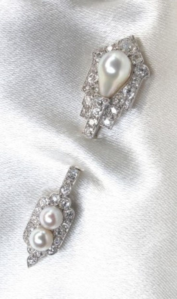 A superbly elegant Art Deco natural pearl, diamond, and platinum jabot brooch, by Cartier.
