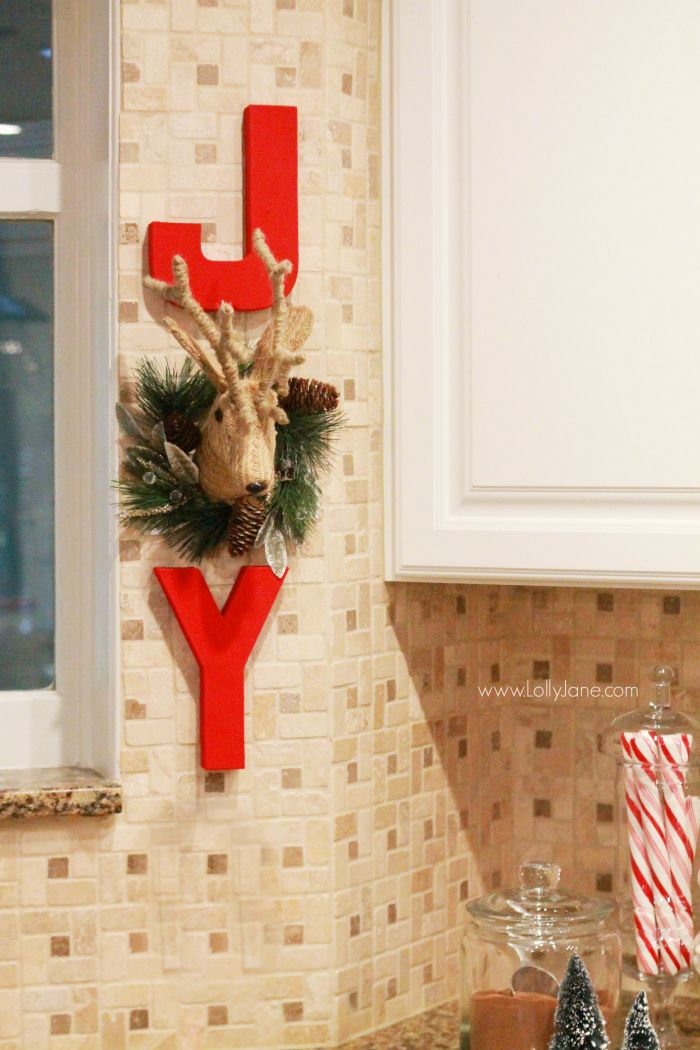 DIY | Adorable JOY Christmas wall decor. Cute way to dress up your kitchen. Click through for cute Christmas kitchen decor ideas.