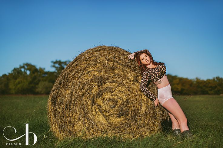 Country forest boudoir portrait photo session with tall grass fields, hay bales and cowboy boots by Stacy Reeves for Blushd Studio in Dallas Texas