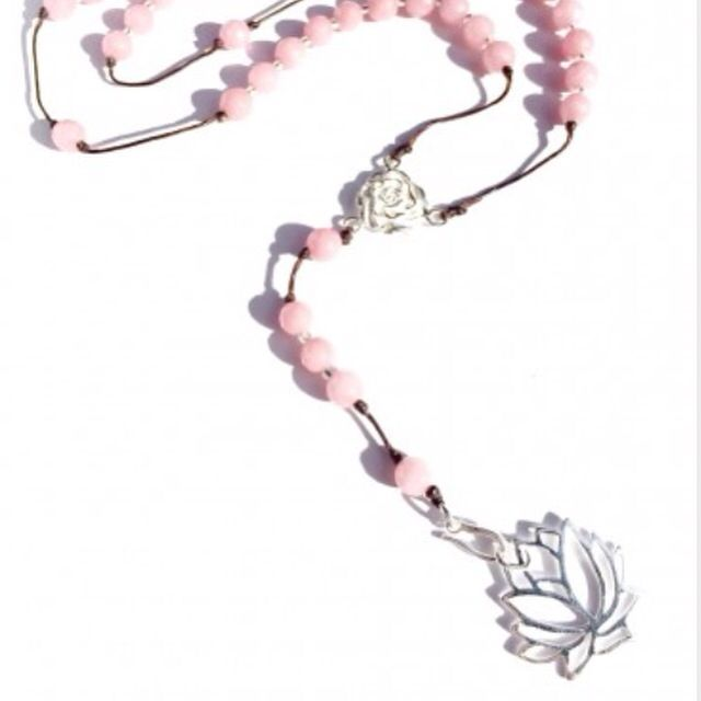 Lotus LOVE Heart Mala Rosary beads are handmade with loving intention from healing Pink Rhodochrosite & blessed with a beautiful Sterling Silver plated Lotus pendant. Each of our Rosary Beads carry specific healing and energetic qualities depending on the Gemstones and Sacred Charms.  <>$54<>  http://heartmala.com/rosary-beads/pink-rhodochrosite-rosary-beads-silver-lotus-pendant.html