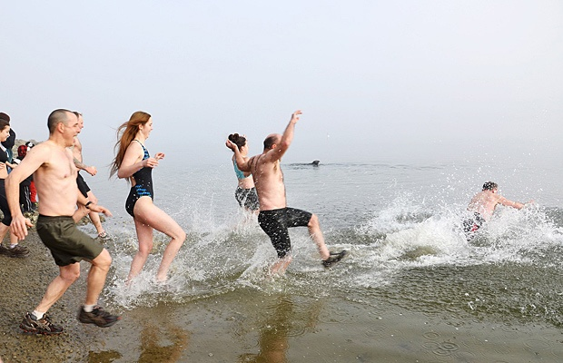 About 20 people take a quick dip into Alouette Lake on Jan. 1 as part of the annual Polar Bear Swim.