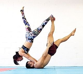 acro yoga  combination of shoulder stand and handstand