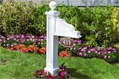 Address Plaque Post installed in a flower bed in front of a house