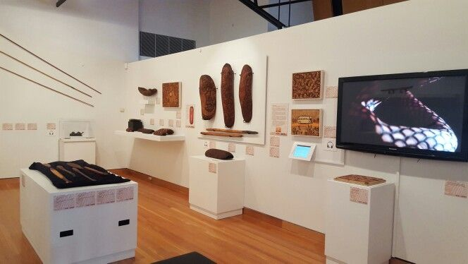 This exhibition includes 88 punu works featuring burnt designs on carved wooden forms.