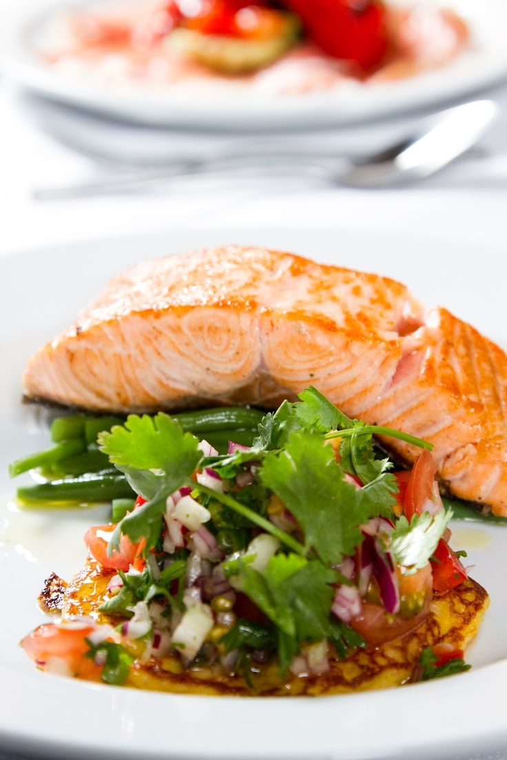 Grilled salmon with a corriander and lime salsa and sweetcorn fritters.