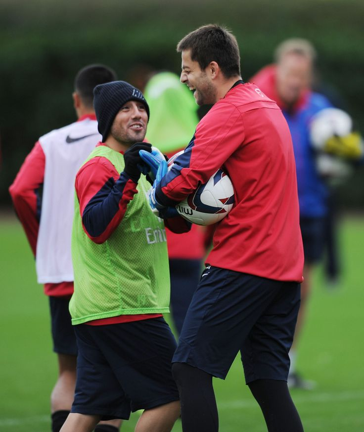 ST ALBANS, ENGLAND - OCTOBER 28:  (L-R) Santi Cazorla and Lukasz Fabianski of Arsenal during a training session at London Colney on October 28, 2013 in St Albans, England.  (Photo by Stuart MacFarlane/Arsenal FC via Getty Images)