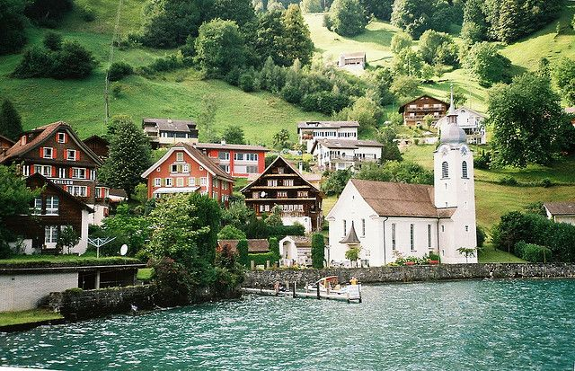 Switzertland - boat ride on Lake Lucerne. The picturesque town of Bauen sqeezed in between the mountains and the Vierwaldstättersee.