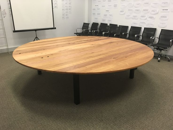 Round conference table.  3000mm round.  30mm messmate.  Custom steel base.  4 pieces.