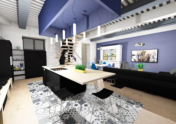 Cuisine noire mat avec faux-plafond de couleur bleu en rappel du mur du salon. Au sol un tapis en carreaux ciment fait le contour de l'ilot de cuisine avec le plan de travail en bois.
