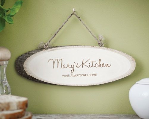 Wooden Kitchen Sign (£18) Laser engraved birch wood with a rustic feel. The word 'Kitchen'comes as standard. Thick woven cord to hang. H9.1x W26.2 x D 1cm. Personalise with name up to 12 characters on 1st line and message up to 25 characters. 'Kitchen' is fixed. This item is a natural product and part of the charm is that it has a grain and occasionally some knots in the wood.