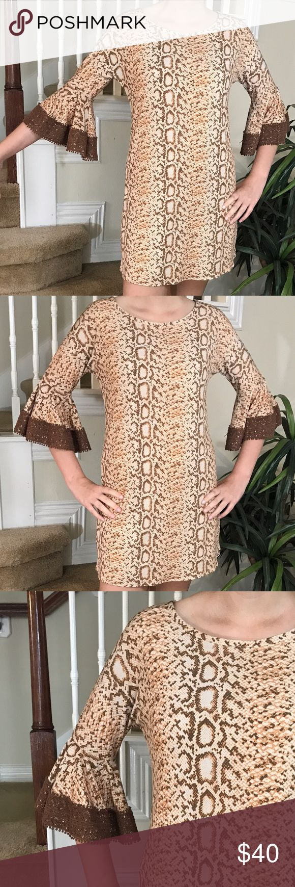 Judith March Crochet flare sleeve dress Gorgeous alert! This Judith March is amazing with its flared Crochet sleeves, animal print sheath, fully lined, popover style and in great condition! Love this one!!! Judith March Dresses