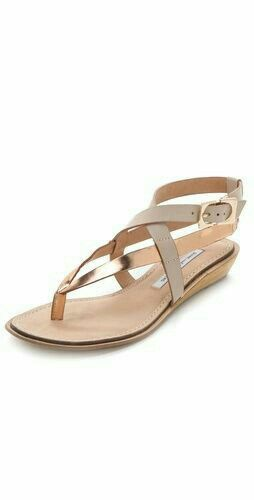 Diane von Furstenberg Dottie Wedge Sandals Two-tone straps in smooth and  metallic leather contour a stylishly secure fit for chic DVF sandals.