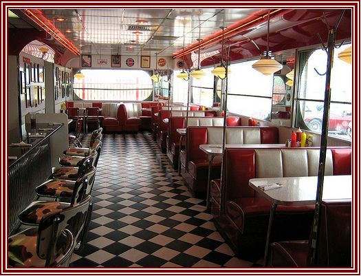 What my kitchen/dining room will be like!! Modeled after a fifties diner!! :) Complete with the booths, the bar stools, and the black and white checked floor!!