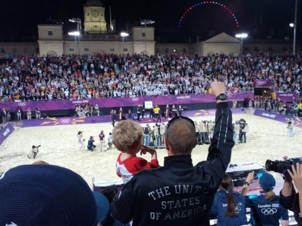 Women's medal ceremony at London 2012 beach volleyball Horse Guards Parade, Casey Jennings celebrates from the stands