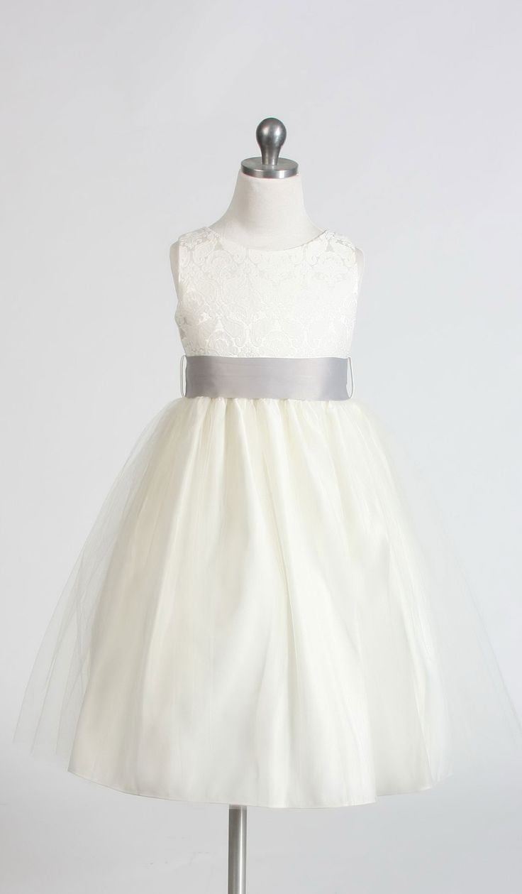 An elegant style perfect for a wedding. The jacquard bodice is truly the highlight of the dress not to mention this style comes in endless removable sash color options! The dress is fully lined for complete coverage to ensure that your princess stays comfortable. Additional netting underneath adds to a fuller look . Zipper closure. This dress is made from a designer label that upholds to the highest in quality and super cute style and value. Do not miss out on this dress! Proudly made in the…
