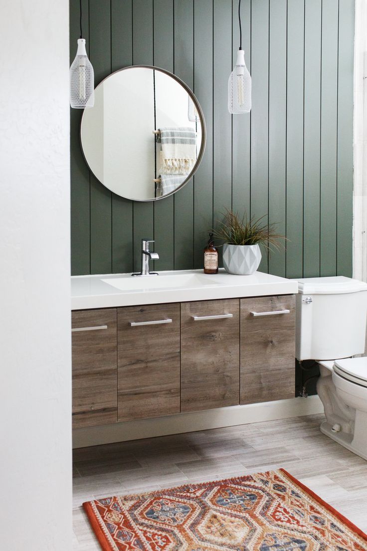 dark green shiplap with distressed floating wood vanity